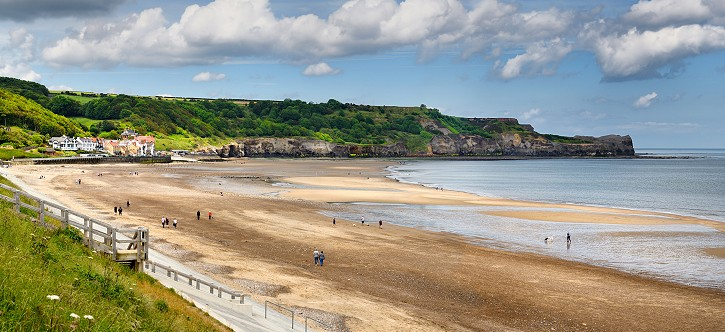 Panorama of Sandsend fishing village and dog friendly Sandsend beach on the North Sea North York Moors National Park England